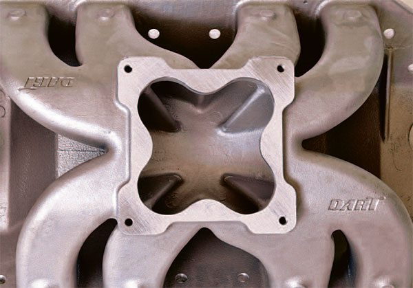 Single-plane intakes like this Dart unit for a 4500 Dominator expose all eight intake ports to a common plenum chamber. They generally provide more even fuel distribution and superior power from about 5,000 to 5,500 rpm on up. Taller versions and those with open spacers often gain power because they soften the exchange of pressure pulses between cylinders due to increased volume and an easier flow path.