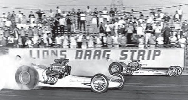 The famous 30-foot-long Lions Drag Strip sign is an iconic symbol. It served as a wonderful background for thousands of action photos such as this one, featuring the legendary Greer/Black/Prudhomme dragster in the near lane, with Chris Karamesines' Chizler pulling ahead in the far lane. (Photo Courtesy Don Gillespie Collection)