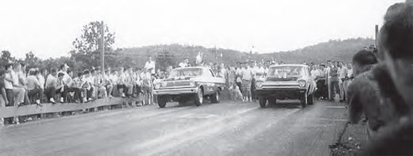 Drag racing in the South had a huge element of danger, not only for the racers but also for the spectators. As you can see in this picture from Paradise Drag Strip in Calhoun, Georgia, spectators lined the wooden guardrails, and even propped up their feet on the rail as Howard Neal and Robert Nance leave the line. (Photo Courtesy Walter Parsons)