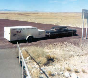 """Ramp trucks were very common forms of transporting drag cars in the 1960s, as were regular passenger cars with custom dragster trailers. It was generally assumed that low-budget racers flat-towed their race cars to the track, while the """"big-money"""" teams used car haulers and trailers. (Photo Courtesy Norbert Locke)"""