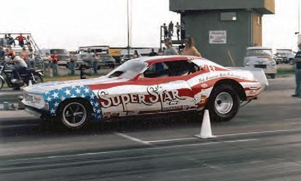 Now here's an interesting matchup that you probably wouldn't see today because of the countless safety regulations it violates. You have Jim Strobel in his Super Star funny car, lined up against what looks like a stock street bike in the far lane. (Photo Courtesy Steve Jackson)