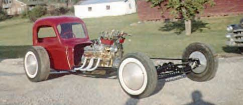 It's hard to deny the creativity used in drag racing during the 1950s and 1960s. This wild dragster was built and raced by Red Stanley. It is a prime example of ingenuity, with its heavily drilled front axle, aerodynamic inner and outer wheel discs, and an interesting engine setup with six carburetors. (Photo Courtesy Larry Rose Collection)