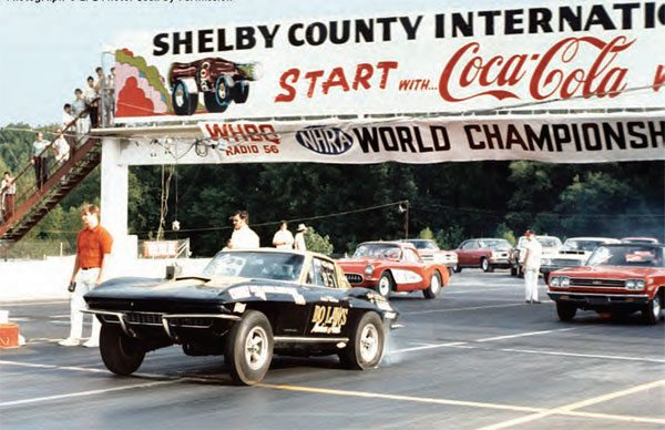 Famous racer Bo Laws makes a hard launch at Lakeland during a big NHRA World Championship event. When the track made changes to include a road course, it also changed its name to Shelby County International Raceway. During the track revamp, a catwalk was added just behind the start line. (Photo Courtesy LPC Photo, Larry Chambers)