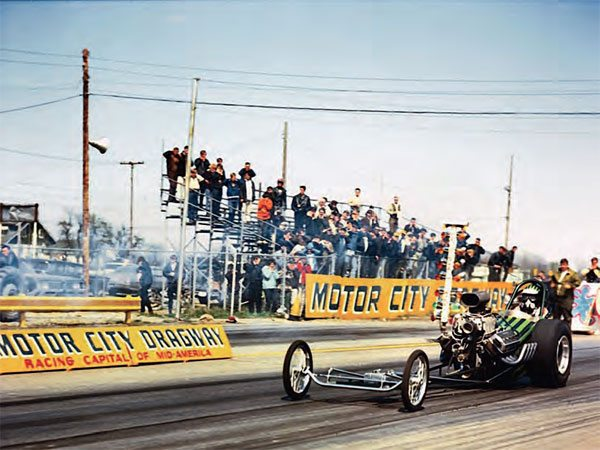 With bright yellow paint and nicely painted lettering, the Motor City Dragway signage always stood out well in photographs. This amazing shot provides a nice view of the racing surface, as well as the very close bleacher location, which offered a great view of the action! (Photo Courtesy JoeStevensPhotos.com)