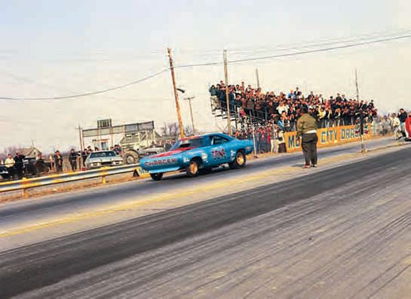 This photograph shows Norm Lupo's 1956 Chevy leaving the line in a fury. The '56 Bel Air hardtop is a nice example of a 1960s-style drag car, and this photo does a great job of showing the surroundings of the track. Behind the racing surface was a farm house and barn. (Photo Courtesy JoeStevensPhotos.com)