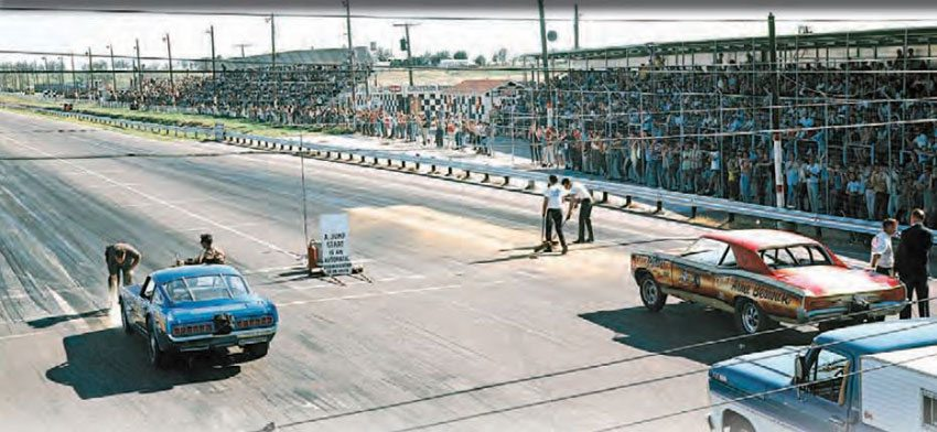 Green Valley Raceway was no backwoods outlaw track. It was a premier track of the South, and attracted thousands of great drag racers to its quarter-mile facility in Smithfield, Texas. Here, the Stone, Woods & Cook Mustang squares off against Arnie Beswick's GTO in a highly anticipated Funny Car match race. (Photo Courtesy Jay S. Magnum)