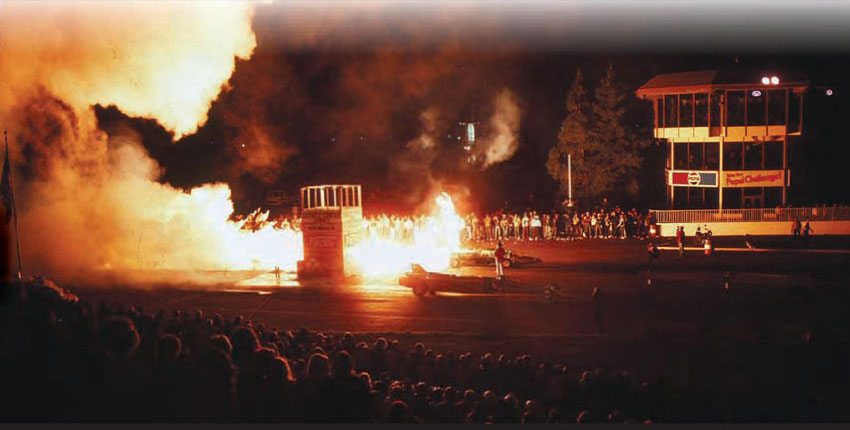 There's nothing quite like the wow factor of two jet cars facing off! With fi re, incredible noise, and blistering speeds, these exhibition cars were always a big hit. This shot offers a view of the OCIR timing tower, illuminated by fire from the Doug Rose Green Mamba jet car. (Photo Courtesy Don Gillespie Collection)