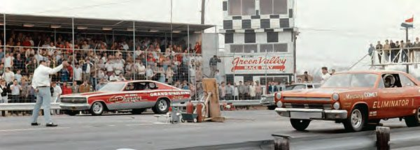 """Green Valley Raceway had lots of room for spectators, which made it a great place for national events. Folks packed the stands and lined up on the catwalk to get a good view of the action. Here is yet another great Funny Car match up—""""Dyno Don"""" and Mr. Norm from 1966. (Photo Courtesy Jay S. Magnum)"""