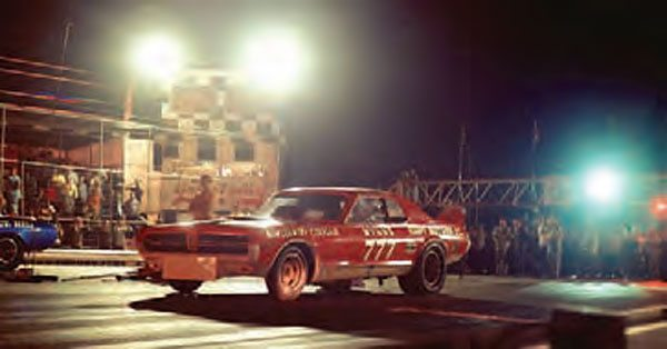 The tower at Green Valley always stood out with its blackand- white checkerboard paint scheme, but the tower did move from one side of the track to the other on a few occasions. The covered bleachers and catwalk were also big features of the track, but most people remember it for the cars. (Photo Courtesy Jay S. Magnum)