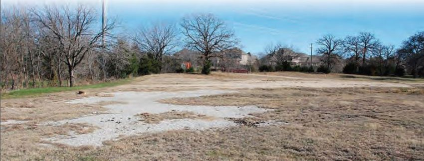 Unfortunately, this is all that remains of the legendary Green Valley Raceway facility. After the track closed in 1986, it sat vacant for several years, until developers chose to use the land for a new subdivision. The original pavement still resides on both sides of the subdivision, but there isn't much left of it. (Photo Courtesy Steve Scott)
