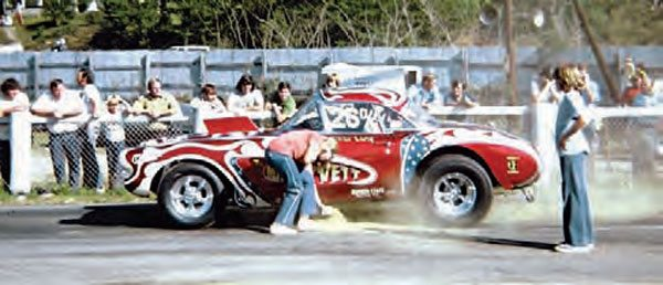"""Traction was hard to find in the old days. Racers often resorted to their own form of traction compound, commonly referred to as """"gold dust."""" The racer's crew sprinkled the rosin on the track, making sure the rear tires passed through it during the burn-out. Here, at Drag City in Ringgold, Georgia, some dust is applied. (Photo Courtesy Wayne Holland)"""