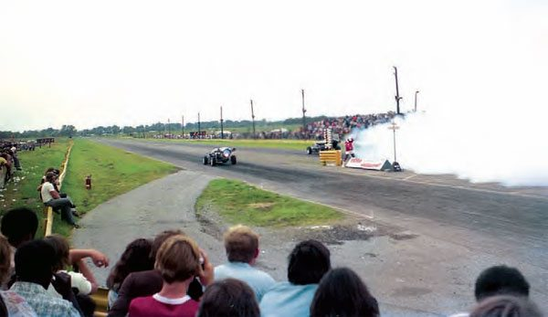 This shot of a jet-car match race shows the track after a few upgrades, including paving the strip of grass between the two lanes. Jet-car racing eventually caused major problems for the track, as the local government enforced a strict noise ordinance that required a special permit for any event featuring jet cars. (Photo Courtesy Larry Rzepczynski)