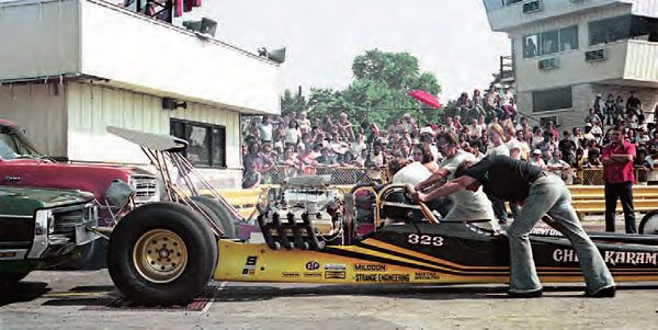 """The track was always considered a well-equipped facility that catered to its racers and spectators. Here, Chris """"The Greek"""" Karamesines is strapped into his fuel dragster, which is sitting atop the in-ground rollers. In the background is the new timing tower, which didn't see many years of use. (Photo Courtesy Mike Sopko)"""