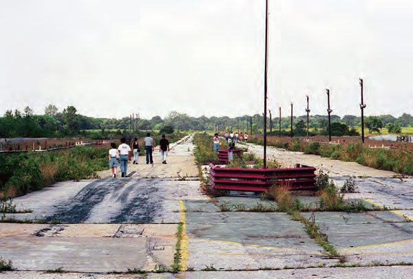 Looking down track in this shot from 1992, you can see that the guardrails are still in place and the racing surface is in very poor condition, after just eight years of neglect. The signature grass in the center of the track's two lanes eventually overtook the pavement between them once again. (Photo Courtesy Mike Sopko)