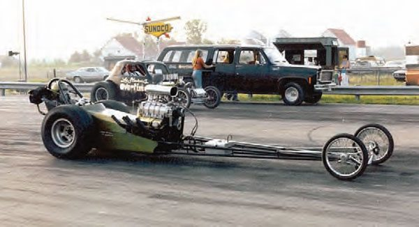 Although many drag racers shifted focus from dragsters to door cars in the 1970s, the old-style rail jobs were still popular with spectators. Here, the supercharged small-block Chevy-powered dragster in the near lane has a tough opponent in Overtime, Lee Stewart's injected Fiat altered in the far lane. (Photo Courtesy Steve Jackson)