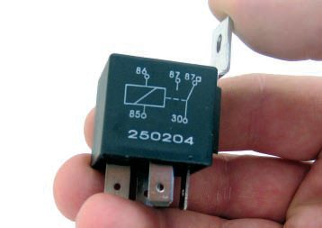 This same relay has the electrical diagram screened on the side of the body itself. Obviously, this is an S.P.D.T. relay given the style of switch shown in the diagram.