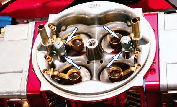 This is the business end of the accelerator pump system. The pump jets, commonly called squirters, are available in a wide range of sizes to calibrate not so much the amount of fuel injected but more the length of time the injection period lasts.