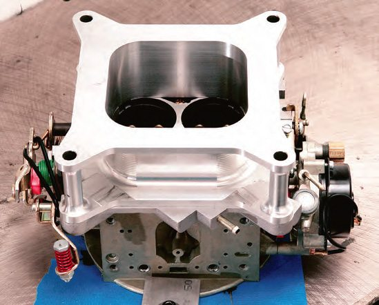 For such a simple change, a spacer can be worth a surprising amount of extra power, particularly on a large or highRPM engine or an engine with too small a carb. The place to find out if your engine needs one is on the dyno or at the track.