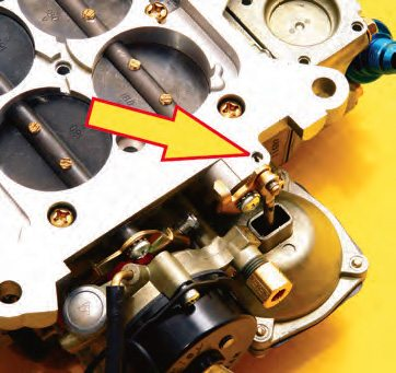 For those carbs not equipped with a secondary idle-speed adjustment screw on the linkage, the idle-speed stop, situated on the underside of the base plate, adjusts idle speed.