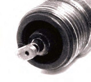 The electrode on this plug has been converted to the lower voltage/ higher energy design in Figure 5.11.