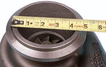 This turbocharger (size T-76) offers a relatively large exhaust diameter. This application accepts an exhaust pipe of 4.5-inch ID. The large flange lip allows the use of a V-groove clamp.