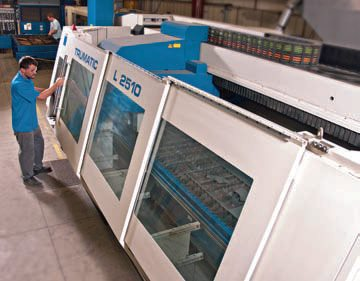 Production header manufacturers commonly take advantage of advanced laser-cutting machines to produce exhaust flanges. This high-capacity laser at Stainless Works produces hundreds of exhaust flanges daily, providing a high degree of precision.