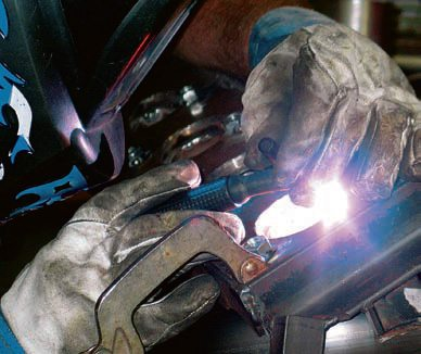 While the header group is secured in its jig, each primary tube is carefully welded to the mounting flange. TIG welding is generally preferred, which allows the welder to fuse elements together in tighter spaces and with minimal weld-bead buildup. Although a talented MIG welder may be able to accomplish the task, TIG lends itself to neater, smaller weld seams with less chance of burning through the pipe.