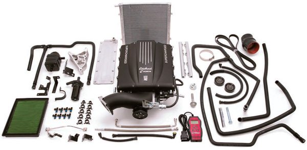 Most supercharger kits, such as the one shown here, include everything required for the installation. Depending on the type of supercharger and the specific manufacturer, kits may include (in addition to the supercharger itself) an intercooler, programmer (for EFI applications), electric fuel pump, regulator, special air intake, and serpentine-belt idler pulley. (Photo Courtesy Edelbrock)