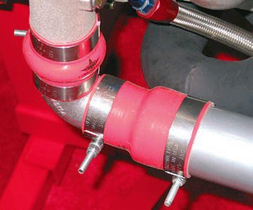 Air-charge piping routed from the turbocharger to the intercooler may be connected using high-temperature silicone sleeves, which are available in a variety of diameters, including stepped adapter sizes. The sleeves are secured to the pipes using T-bolt band clamps.