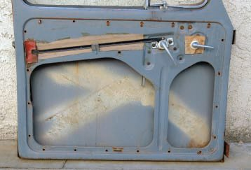 Here's another good example of metal that doesn't need stripping. This is a '56 VW door, but it could be a whole car. Amazingly, after 50 years, it still has factory-original paint on it—the fact the inside matches the outside is a good clue—with virtually no dents, and very complete.