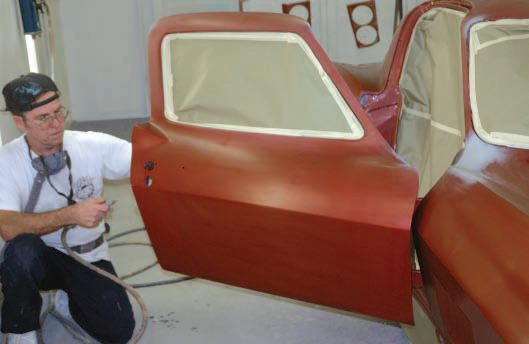 Be sure to blow out anything that might have settled in the masking paper, and tack-wipe all paint surfaces, including doorjambs, hood compartment, and so on.