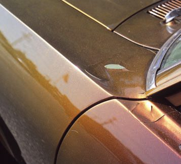 "In the prior examples the existing or underlying paint was unstable. In this case a painter for a local bodyshop added a smooth, glossy—and very expen-sive—coat of ""flip-flop"" custom paint to his otherwise original Nova. There was nothing wrong with the existing pea green factory paint (except the color), but he failed to sand it sufficiently or use any primer or sealer to make the new paint stick, with apparent results. Given that it's already peeling, you could probably remove the top layer only, using liquid stripper."