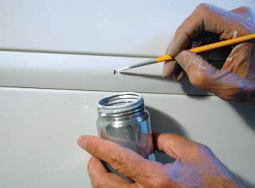 But we're really talking about preparing a car with some nicks and bruises for a pearl-coat. So, after your spot painting, use a small brush and the leftover catalyzed paint in the spray gun cup to go around the whole car touching up any small chips or nicks still left.