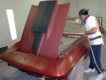 """Since the surface was all painted to start with, John didn't need an etching primer or a sealer, as such, but he wisely decided to start with a clear DuPont product appropriately called """"Mid-Coat Adhesion Promoter."""" He started by spraying a thin layer inside the engine compartment and doorjambs."""