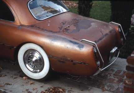 "Here's an interesting case. This shoebox Ford was a famous custom, first built in a simpler, red form by well-known Valley Custom in the early '50s, then rebuilt by them in this version later in the decade. It hasn't been touched since, but has been left outside and surface rust is forming. Should a restorer try to ""save"" as much as possible, as is, or disassemble and strip the car to bare metal for full restoration? This surface rust looks pretty serious, and I think the latter is probably necessary (if it ever gets restored)."