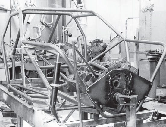 The nearly complete skeleton of Grumpy's Toy XI is laid up on the chassis jig at SRD. The completed chassis weighed a shade more than 100 pounds. Note the high-strut mount that required additional hood clearance. The strut was modifi ed on later Toys, allowing for a lower profi le.