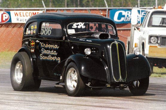The team's second Anglia was completed in 1969 and raced into 1974. Best clocking was a 9.02 at 156 mph. The car features the standard fi berglass parts, along with plexiglass windows and a 3-inch top chop. Darrell Hanson sprayed the original black lacquer. (Photo Courtesy Dave Davis)