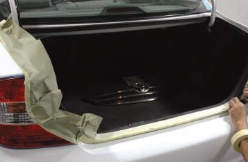 If I were doing this myself, I would have masked some black weatherstrip moldings, such as those around the trunk, that were susceptible to over-spray through seams.