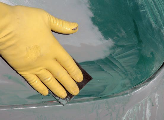 Even wet sanding with finer paper, you should use a rubber backing pad. If you're hand-sanding, however, do not use your fingertips, especially in a parallel motion, because it makes grooves as seen in the first photo. Instead, turn your hand at an angle to the direction of sanding, as demonstrated in the second picture.