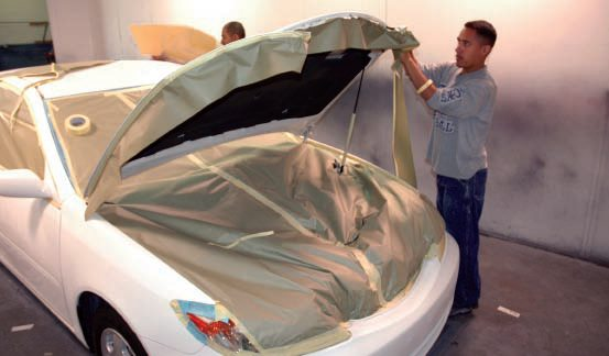 But these guys, who usually do partial paint jobs (spot-ins) on newer cars, went to town masking off the trunk, engine, and all door seams so no overspray would get anywhere. I don't think that's necessary. A little rubbing compound usually quickly removes what overspray gets in doorjambs, etc.  But I hate masking. It's up to you; you've only got yourself to please.