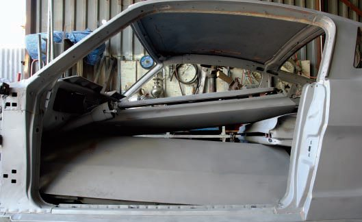 A good thing about media blasting is that it can be used selectively, and the car can be disassembled (or not) as much as you want. This one got the whole interior blasted, including the dash, roof, and even the steering column. A good blaster can also leave plastic fillers in place, if you want, as seen around the doorjambs.