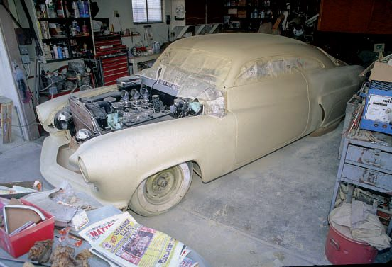 After the car was washed with water, which neutralizes the stripper, Jim went over the body with a Metalprep-type wash, followed by a coat of VeriPrime etching primer, and then a layer of K200 high-fill primer, as shown here. We show the rest of the paint job on this car in Chapter 10.