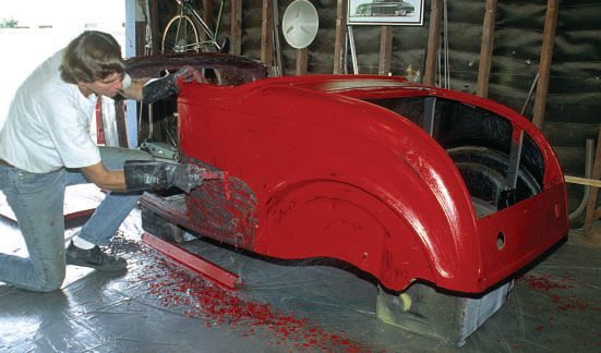 I have used aircraft stripper on a few projects in my garage, this one being my '32 Ford roadster body. Fortunately it only had one layer of red lacquer over primer (lacquers are the easiest to strip; new catalyzed paints are much harder to remove). Note that I'm wearing big, thick rubber gloves, and I have the floor covered with thick plastic to catch the corrosive droppings.