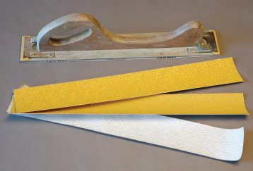 """Buy strips of 36, 80, and 180 grit paper made to fit the """"longboard"""" or """"filler board.""""  Cut them to fit shorter blocks. Most bodywork sanding is done with 36 grit. Use 80 grit on high-fill primers and spot putty. The 180 and finer-grit papers are covered under prepping and block sanding in Chapter 6."""