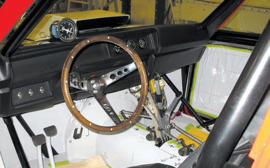 Restoration of the Grumpy's Toy interior is nearing completion showing the protected tinwork installed and the Lenco levers poking through the tunnel. Accel ignition components are mounted inside to keep them away from the heat of the engine bay. (Photo Courtesy Scott Hoerr)
