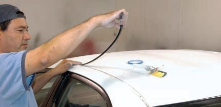 Trim on newer cars is minimal, but its removal can be mysterious, too. The black rubber strips in the roof (what are they for, anyway?) are usually held by clips at each end and pop and peel out easily after a little wiggling.