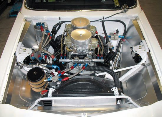The heart of Grumpy's Toy XI was the 680-horse 331. A pair of heavily modified Holley Dominator carbs is fed through an equally trick Edelbrock TR-1X manifold. Compression was in the neighborhood of 15:1. Having a back door to General Motors, Bill was able to have the cores to the 292 Turbo cylinder heads modified to his liking. (Photo Courtesy Scott Hoerr)