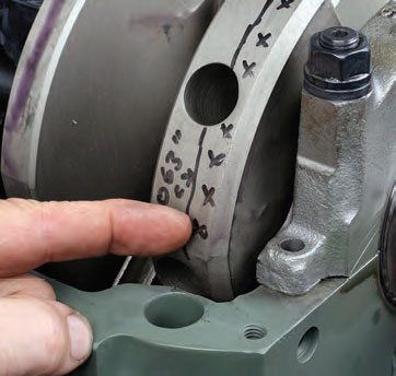 When test fitting the crankshaft (with main bearings installed and lubed), check crank counterweight-to-block clearance, especially when using a stroker crank. This increased-stroke crank in a Pontiac 455 block had a fairly tight clearance between the forward area of the front counterweight and the block, just above the oil-pan rail. Once the crank was removed, hand grinding removed a small bit of material from the block to achieve a comfy .050-inch clearance at this tight spot.