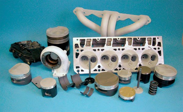This group of parts helps to illustrate heat barrier and anti-friction coating applications. The examples shown here include high-temperature thermal-barrier coatings on head chambers, piston domes, turbo housing, and headers; anti-friction coatings on skirts, valvestems and bearings; and heat-release (or shedding) coatings on valvesprings. (Photo Courtesy Swain Tech Coatings)