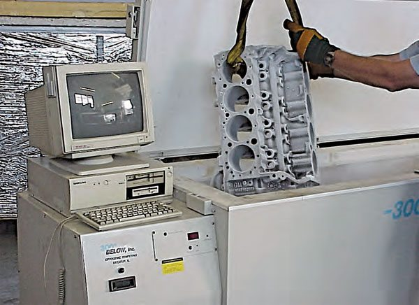 Cryogenic metal tempering requires a specialized, computer-controlled cryo tank that uses liquid nitrogen, in which components are exposed to temperatures at approximately –400 degree F. The pieces are cooled in a slow, controlled manner, then allowed to come back to ambient temperature in a controlled process. The engine block in this photo was removed from the tank only for the photo. Notice the white frosty surface, resulting from the frozen part exposed to room temperature.